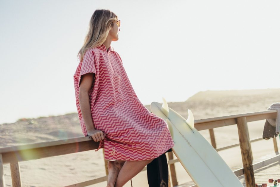 a surfer wearing a surf poncho