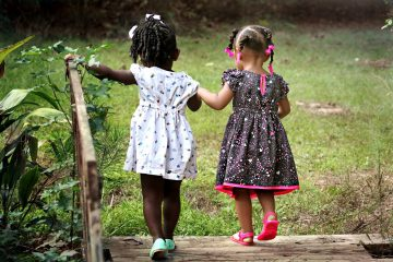two little girls developing social skills